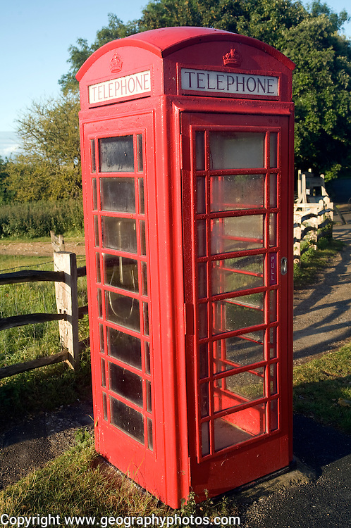Traditional red telephone box in the countryside, Sussex, England