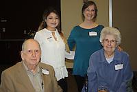 NWA Democrat-Gazette/CARIN SCHOPPMEYER Ben and EvaLena Mayo (seated) visit with Nereida Aranda Almoroz (left) and Kathryn Birkhead at the NWACC scholarship luncheon.