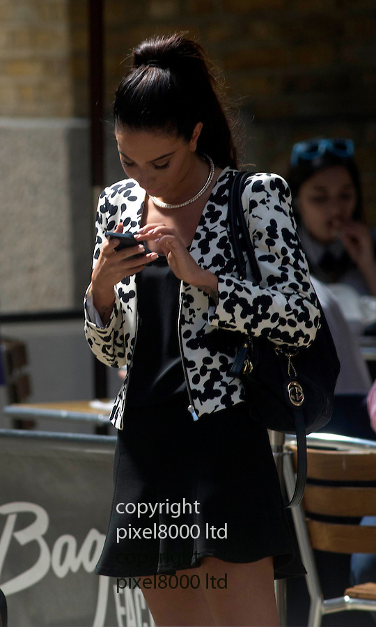 Pic shows: Tulisa Contostavlos lunches near at Southwark Crown  Court today with a cigarette and can of drink and checks if her makeup make up is perfect.<br /> <br /> expression smoking<br /> <br /> <br /> <br /> <br /> <br /> Pic by Gavin Rodgers/Pixel 8000 Ltd