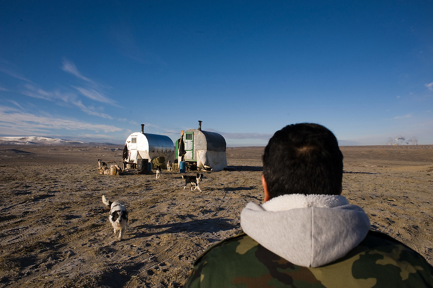 Activist and former Chilean sheep herder Jose (acute accent on e) Ruiz, greets Lorenzo Cortez Vargas at his campito, or small camp trailer, on Bureau of Land Management land outside of Rock Springs, Wyo., Saturday, Feb. 7, 2009. Sheepherders working in southern Wyoming along the Colorado border complain of low pay, poor accomodations and lack of health care after they arrive on H2A visas to work for local ranchers. (Kevin Moloney for the New York Times)