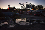 QUEENS, NY -- OCTOBER 22, 2013:  Citi Field is reflected in a puddle in Willets Point on October 22, 2013 in Queens.  Photographer: Michael Nagle for The New York Times