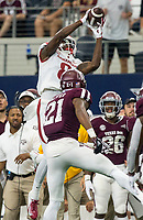 Hawgs Illustrated/Ben Goff<br /> Mike Woods, Arkansas wide receiver, catches a pass under pressure from Charles Oliver, Texas A&M cornerback, in the 3rd quarter Saturday, Sept. 29, 2018, during the Southwest Classic at AT&T Stadium in Arlington, Texas.