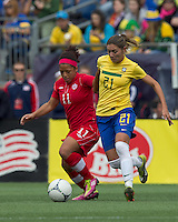 Canadian midfielder Desiree Scott (11) dribbles as Brazilian player Gabriella Demoiser (21) pressures. In an international friendly, Canada defeated Brasil, 2-1, at Gillette Stadium on March 24, 2012.