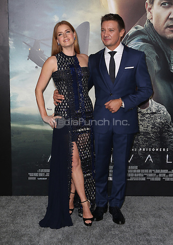 """Westwood, CA - NOVEMBER 06: Amy Adams, Jeremy Renner at Premiere Of Paramount Pictures' """"Arrival"""" At Regency Village Theatre, California on November 06, 2016. Credit: Faye Sadou/MediaPunch"""