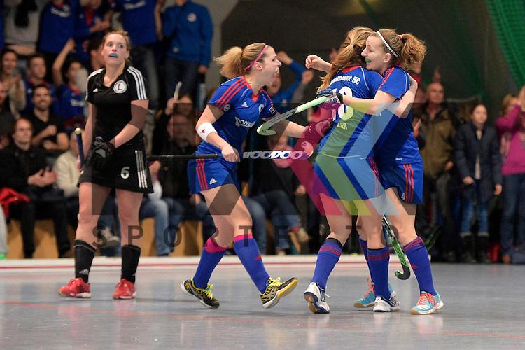 GER - Mannheim, Germany, January 30: During the 1. Bundesliga Damen indoor hockey quarter final match between Mannheimer HC (blue) and TuS Lichterfelde (black) on January 30, 2016 at Irma-Roechling-Halle in Mannheim, Germany.   Nadine Kanler #4 of Mannheimer HC celebrates after scoring the winning goal<br /> <br /> Foto &copy; PIX-Sportfotos *** Foto ist honorarpflichtig! *** Auf Anfrage in hoeherer Qualitaet/Aufloesung. Belegexemplar erbeten. Veroeffentlichung ausschliesslich fuer journalistisch-publizistische Zwecke. For editorial use only.
