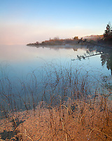 Sleeping Bear Dunes National Lakeshore, Michigan<br /> Fog burning off the calm surface of Loon Lake at dawn, autumn