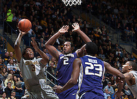 Tyrone Wallace of California shoots the ball during the game against Washington at Haas Pavilion in Berkeley, California on January 15th 2014.  California defeated Washington, 82-56.
