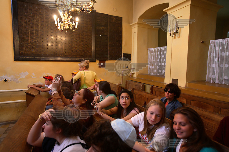 Young Jewish Americans from Pittsburgh visit the Remuh (Remu) Synagogue while sightseeing in Kazimierz district during the Jewish Culture Festival. This synagogue is the only functioning synagogue in Kazimierz.