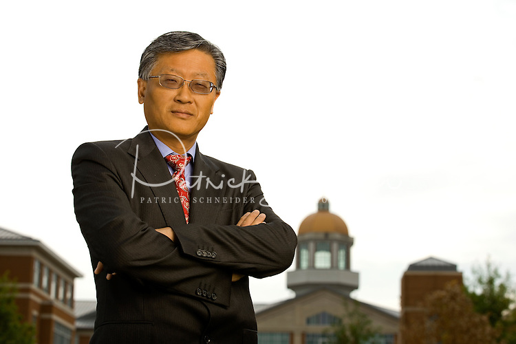 On-location Corporate Portrait of Yi Deng is the Dean and Professor of the College of Computing and Informatics at the University of North Carolina at Charlotte.<br /> <br /> Charlotte Photographer -  PatrickSchneiderPhoto.com