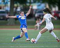 In a National Women's Soccer League Elite (NWSL) match, the Boston Breakers defeated the FC Kansas City, 1-0, at Dilboy Stadium on August 10, 2013.  Boston Breakers defender Rhian Wilkinson (7) tackles FC Kansas City midfielder/forward Erika Tymrak (15).