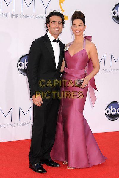 Dario Franchitti, Ashley Judd.The 64th Anual Primetime Emmy Awards - Arrivals, held at Nokia Theatre L.A. Live in Los Angeles, California, USA..September 23rd, 2012.emmys full length black tuxedo white shirt purple pink dress  married husband wife halterneck clutch bag hair up beehive .CAP/ADM/BP.©Byron Purvis/AdMedia/Capital Pictures.