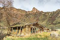 Old deserted log roadhouse near Challis Idaho