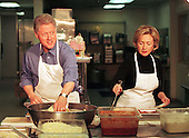 United States President Bill Clinton and first lady Hillary Rodham Clinton work at the DC Central Kitchen making lasagna to feed the homeless December 21, 1998. Despite his impeachment President Clinton is enjoying some of the highest job approval ratings of his six years in office.  .Credit: Richard Ellis - Pool / CNP