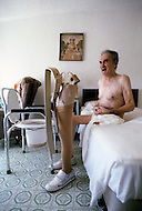 Miami, Florida, U.S.A, September, 1980. America severely marked by the recession.  In Miami Beach where there is great concentration of old people, they live in hotel rooms or furnished apartments. They spent most of their time indoors from fear of being attacked or being robbed. Many are ill or physically handicapped.