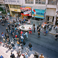 Strikers from Piraeus Port arguing with two workers in the street at the end of a demonstration during the financial crisis.