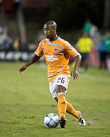 Houston Dynamo midfielder Corey Ashe (26)dribbles the ball.  Houston Dynamo defeated Atlante FC 4-0  during the group stage of the Superliga 2008 tournament at Robertson Stadium in Houston, TX on July 12, 2008.