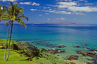 Aerial view of the Kihei coastline with the island of Kaho'olawe in the distance.