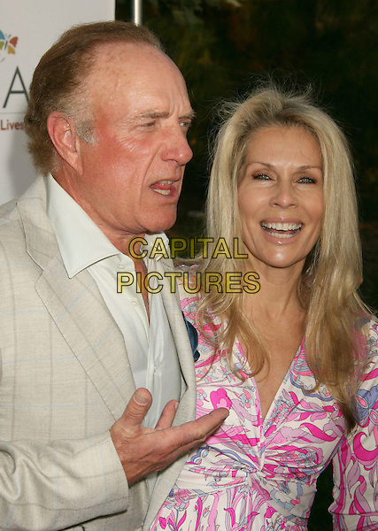 JAMES CAAN & LINDA STOKES.Sixth Annual Chrysalis Butterfly Ball held at the Home of Susan Harris and Hayward Kaiser, Mandeville Canyon, California, USA..June 2nd, 2007.half length beige jacket mouth open hand pink pattern married husband wife.CAP/ADM/RE.©Russ Elliot/AdMedia/Capital Pictures *** Local Caption *** ..