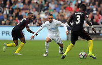 Leon Britton of Swansea City (C) against Raheem Sterling (L) and Bacary Sagna of Manchester City during the Premier League match between Swansea City and Manchester City at The Liberty Stadium in Swansea, Wales, UK. Saturday 24 September 2016