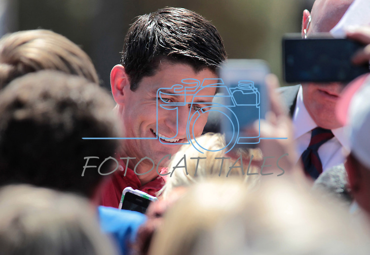 Republican Vice-Presidential candidate Rep. Paul Ryan, R-Wis., greets the crowd at the Peterbilt Truck & Parts Equipment company in Sparks, Nev., on Friday, Sept. 7, 2012. (AP Photo/Cathleen Allison)