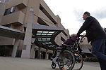 William Massart walks his daughter Sandra Massart, 10,  into Duke University Hospital in Durham, NC, USA, on Tuesday, Feb. 14, 2012.  Sandra Massart is being treated for MLD, a degenerative condition.  Photo by Ted Richardson