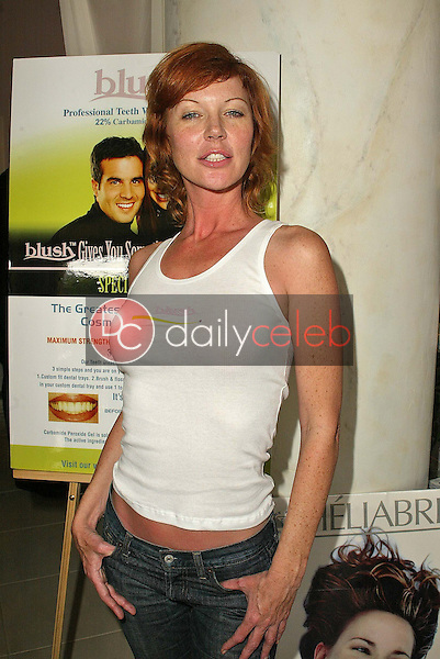 Cynthia Basinet in front of the &quot;Blush&quot; display<br />