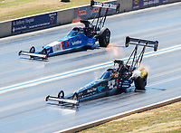 Jul 23, 2017; Morrison, CO, USA; NHRA top fuel driver Clay Millican (near) races alongside XXXX during the Mile High Nationals at Bandimere Speedway. Mandatory Credit: Mark J. Rebilas-USA TODAY Sports