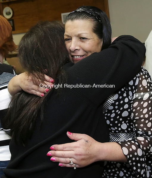 WATERTOWN, CT 4/13/07- 041307BZ15- Angela Mitchell, of Oakville (back to camera), hugs her friend Donna Rado-Nazario at a fundraising dinner for Rado-Nazario at the Oakville VFW Post #7330 Friday night. <br /> Donna Rado-Nazario is battling liver failure.<br /> Jamison C. Bazinet Republican-American