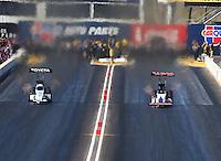 Feb 27, 2016; Chandler, AZ, USA; NHRA top fuel driver Antron Brown (left) races alongside Steve Torrence during qualifying for the Carquest Nationals at Wild Horse Pass Motorsports Park. Mandatory Credit: Mark J. Rebilas-