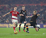 Michael Dawson of Hull City challenges Adam Forshaw of Middlesbrough during the English Premier League match at Riverside Stadium, Middlesbrough. Picture date: December 5th, 2016. Pic Jamie Tyerman/Sportimage