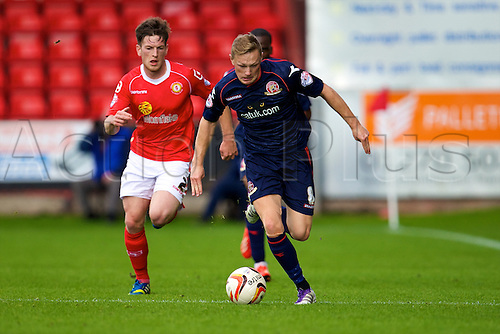 14.09.2013 Crewe, England. Walsall FC Sam Mantom and Crewe Alexandra defender Matt Tootle in action during the League One game between Crewe Alexandra and Walsall FC from the Alexandra Stadium