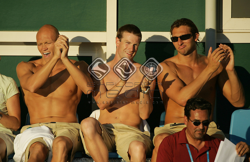 Michael Klim (L), Jono van Hazel and Ian Thorpe enjoy the atmosphere at the Swimming<br /> Swimming - Finals<br /> Summer Olympics - Athens, Greece 2004<br /> Day 06, 19th August 2004.<br /> &copy; Sport the library/Sandra Teddy