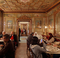 Sala Cinese or Chinese Hall in the Caffe Florian, on St Mark's Square or Piazza San Marco, Venice, Italy. This coffee house was founded in 1720 and is one of the oldest continuously operated cafes in the world. It was restored in 1858 by Lodovico Cadorinj and artists employed to paint on the walls. The city of Venice is an archipelago of 117 small islands separated by canals and linked by bridges, in the Venetian Lagoon. The historical centre of Venice is listed as a UNESCO World Heritage Site. Picture by Manuel Cohen