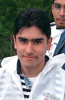Smiling Hispanic man age 20 at Cinco de Mayo celebration.  St Paul  Minnesota USA