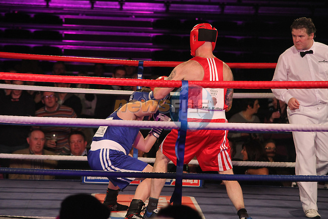 "Niall ""The Killer"" Reynolds (red) sponsored by the Green Man Barbers and Ian McKeown ""The Liquidator"" (blue) sponsored by McKeown and Associates taking part in Drogheda and District, ""Battle of the Barbican"" White Collar Boxing Event in aid of the Des Smyth Foundation...(Photo credit should read Jenny Matthews www.newsfile.ie)....This Picture has been sent you under the conditions enclosed by:.Newsfile Ltd..The Studio,.Millmount Abbey,.Drogheda,.Co Meath..Ireland..Tel: +353(0)41-9871240.Fax: +353(0)41-9871260.GSM: +353(0)86-2500958.email: pictures@newsfile.ie.www.newsfile.ie."