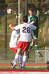 Redondo Beach, CA 02/01/10 - Mira Costa's Drew Walters (C)  (Mira Costa #2) towers over two Redondo defenders and his header sailed over the cross bar.