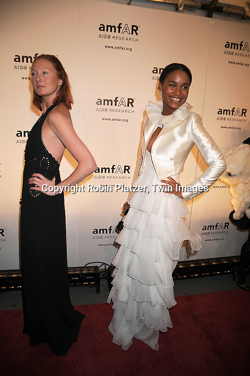 Maggie Rizer and Joy Bryant.posing for photographers at The amFAR New York Gala honoring Julian Schnabel, Carine Roitfeld and Bobby Shriver on January 31, 2008 at Cipriani 42nd Street. ..Robin Platzer, Twin Images..212-935-0770
