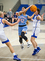 NWA Democrat-Gazette/BEN GOFF @NWABENGOFF<br /> Sabrina Phonkhoumphon, Fort Smith Southside guard, passes the ball vs Rogers Tuesday, Nov. 26, 2019, at King Arena in Rogers.