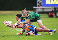 Autumn-Rain Stephens-Daly is tackled by Manawatu's Lauren Balsillie during the women's pool match between Manawatu and Bay Of Plenty on day one of the 2018 Bayleys National Sevens at Rotorua International Stadium in Rotorua, New Zealand on Saturday, 13 January 2018. Photo: Dave Lintott / lintottphoto.co.nz