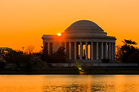 The Jefferson Memorial backlit by the rising sun, Washington, DC