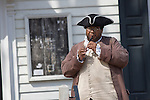 A period actor in Colonial Williamsburg, Virginia plays a flute.