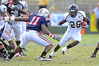 30 October 2010:  FIU running back Darrian Mallary (26) attempts to evade Florida Atlantic linebacker David Hinds (11) in the second quarter as the Florida Atlantic University Owls defeated the FIU Golden Panthers, 21-9, at Lockhart Stadium in Fort Lauderdale, Florida.