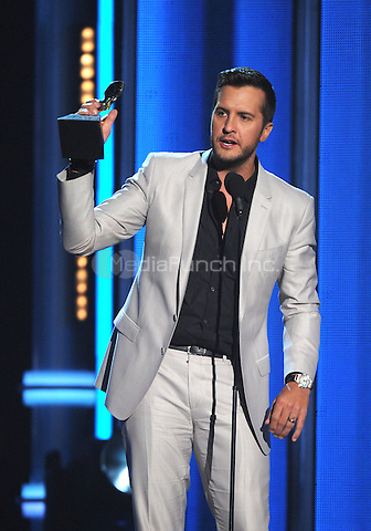 LAS VEGAS, NV - MAY 18: 5 Luke Bryan accepts the Top Country Artist award at the 2014 Billboard Music Awards at the MGM Grand Garden Arena on Sunday, May 18, 2014 in Las Vegas, Nevada. PgMicelotta/MediaPunch