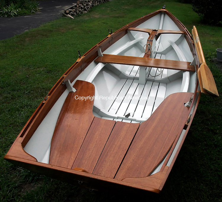 BETHLEHEM, CT-16 August 2005-081605TK09  Mark Ariola creation of a 14 foot Swampscott Dory, a fishing boat that was popular between 150 to 200 years ago. Tom Kabelka staff photo (Martin Ariola, boat builder, Swampscott Dory)CQ