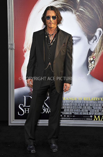 WWW.ACEPIXS.COM . . . . .  ....May 7 2012, LA....Johnny Depp arriving at the premiere of 'Dark Shadows' at Grauman's Chinese Theatre on May 7, 2012 in Hollywood, California.....Please byline: PETER WEST - ACE PICTURES.... *** ***..Ace Pictures, Inc:  ..Philip Vaughan (212) 243-8787 or (646) 769 0430..e-mail: info@acepixs.com..web: http://www.acepixs.com