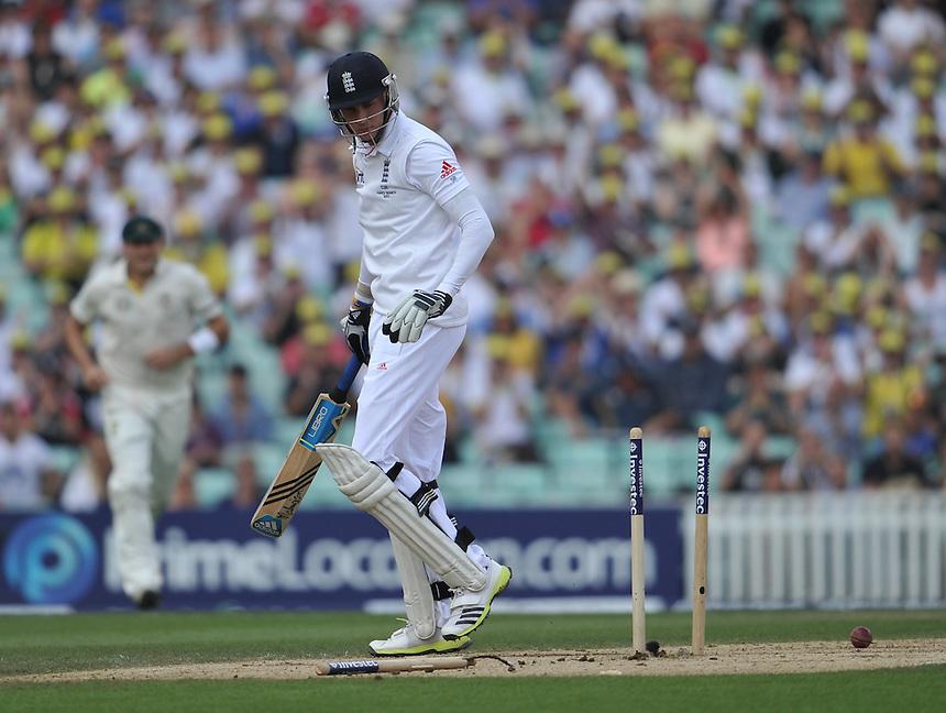 England's Stuart Broad clean bowled by Mitchell Starc <br /> <br /> SCJ Broad b Starc 9<br /> <br />  Photo by Ashley Western/CameraSport <br /> <br /> International Cricket - Fifth Investec Ashes Test Match - England v Australia - Day 5 - Sunday 25th August 2013 - The Kia Oval - London<br /> <br /> &copy; CameraSport - 43 Linden Ave. Countesthorpe. Leicester. England. LE8 5PG - Tel: +44 (0) 116 277 4147 - admin@camerasport.com - www.camerasport.com