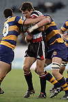Ben Meyer is taken by Murray Williams & Mark Sorenson during the Air NZ Cup rugby game between Bay of Plenty & Counties Manukau played at Blue Chip Stadium, Mt Maunganui on 16th of September, 2006. Bay of Plenty won 38 - 11.