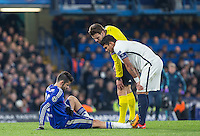 Diego Costa of Chelsea points out his injury to Referee Felix Brych (GER) and Thiago Silva of Paris Saint-Germain before being substituted during the UEFA Champions League Round of 16 2nd leg match between Chelsea and PSG at Stamford Bridge, London, England on 9 March 2016. Photo by Andy Rowland.