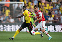 Sokratis Papastathopoulos of Arsenal & Ismaïla Sarr of Watford during the Premier League match between Watford and Arsenal at Vicarage Road, Watford, England on 16 September 2019. Photo by Andy Rowland.