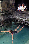 Holywell St Winefrides Shrine. Woman swimming in the healing spring water pool. Holywell Flintshire Wales. 1990s, St Winifred or Saint Winefride was a 7th-century Welsh Christian woman, around whom many historical legends have formed. A healing spring at the traditional site of her death is now a shrine and pilgrimage site called St Winefrifdes Well, known as the Lourdes of Wales.